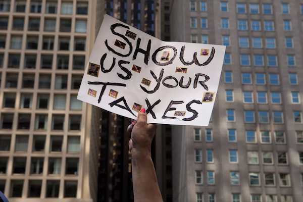 """Sign saying """"Show us your taxes"""" in NYC"""