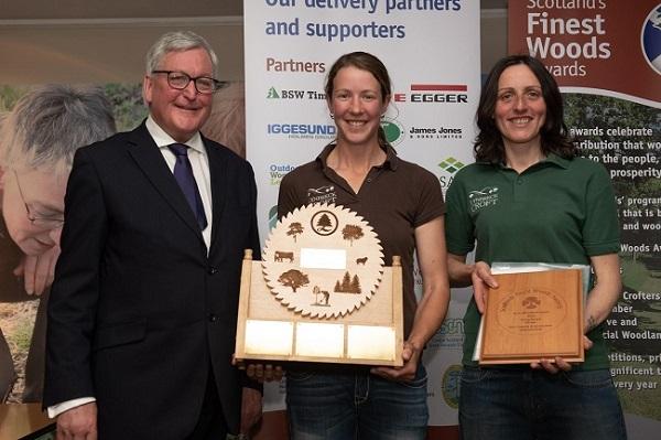 Fergus Ewing presenting the Young People Farm Woodland Award to Sandra Baer (centre) and Lynn Casells, Lynbreck Croft