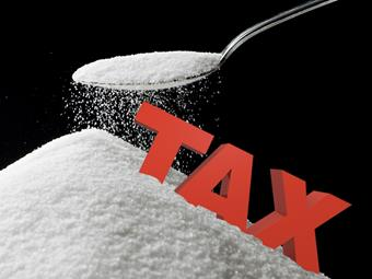 Pile of sugar with the word tax.