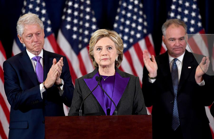 Hillary Clinton, her husband President Bill Clinton (left), and running mate Tim Kaine on Wednesday.