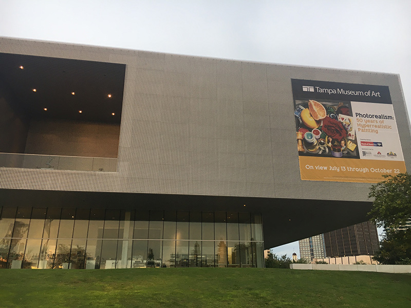 Audrey Flack's painting Queen (1976) advertised on the Tampa Museum of Art's facade.